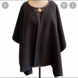 Calvin Klein Black poncho cape with leather trim and gold buckle